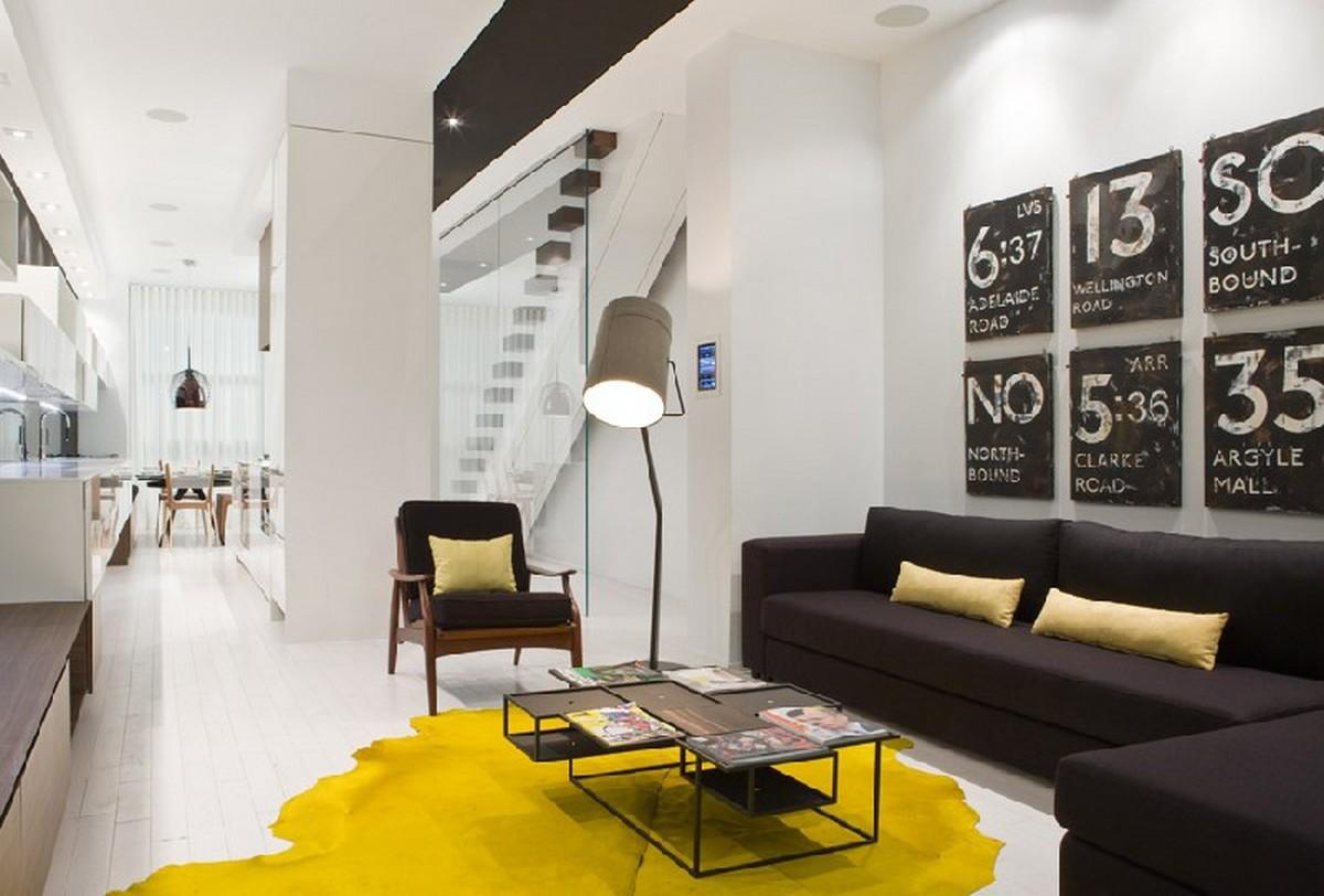 интерьер гостиной в чёрном цвете жёлтые акценты