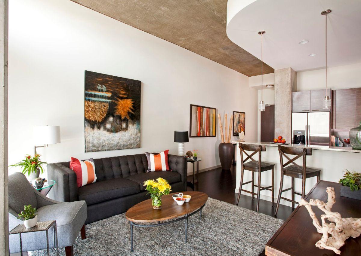 интерьер маленькой квартиры пример выделения кухонной зоны