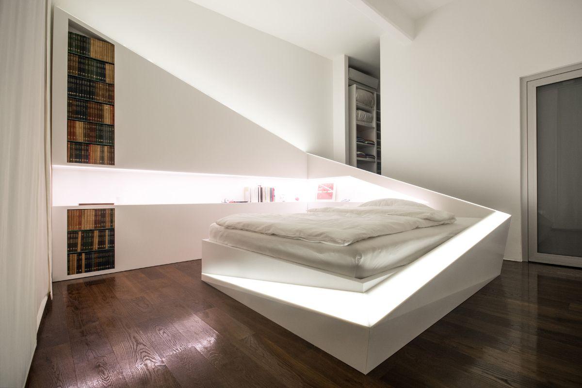 футуристический дизайн спальни с необычной кроватью