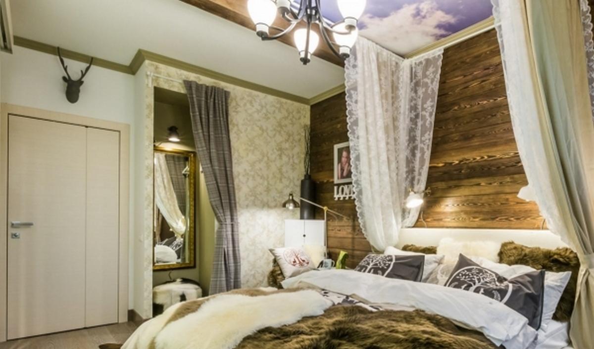 шикарная спальня в стиле шале в загородном доме