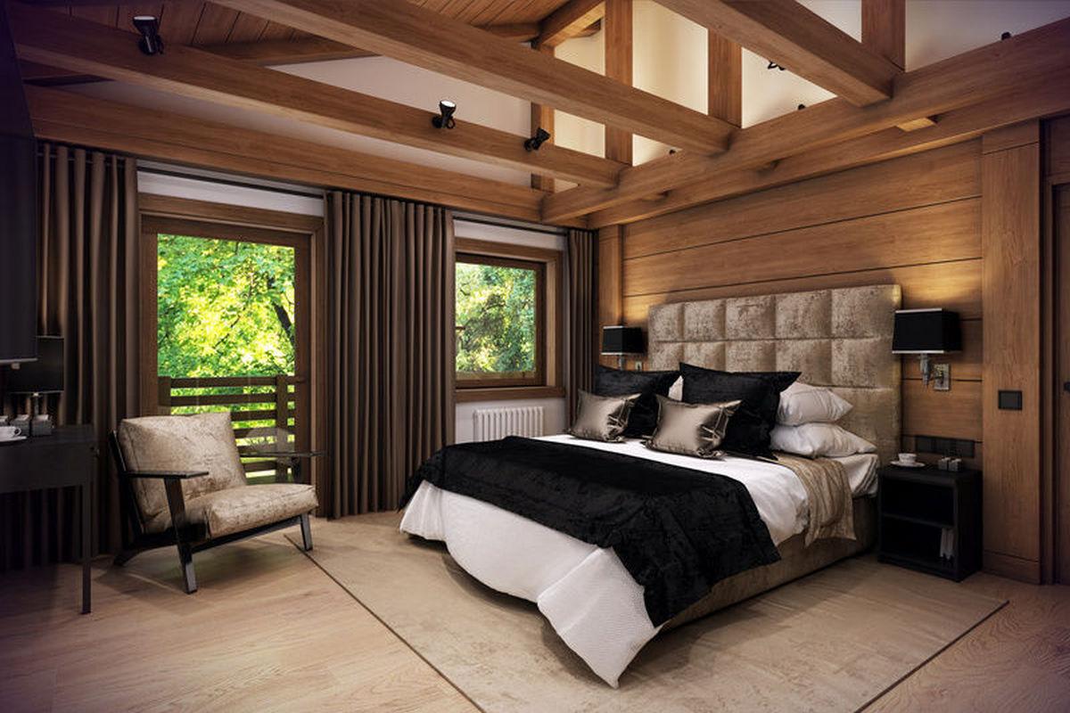 великолепная спальня на мансарде в стиле шале